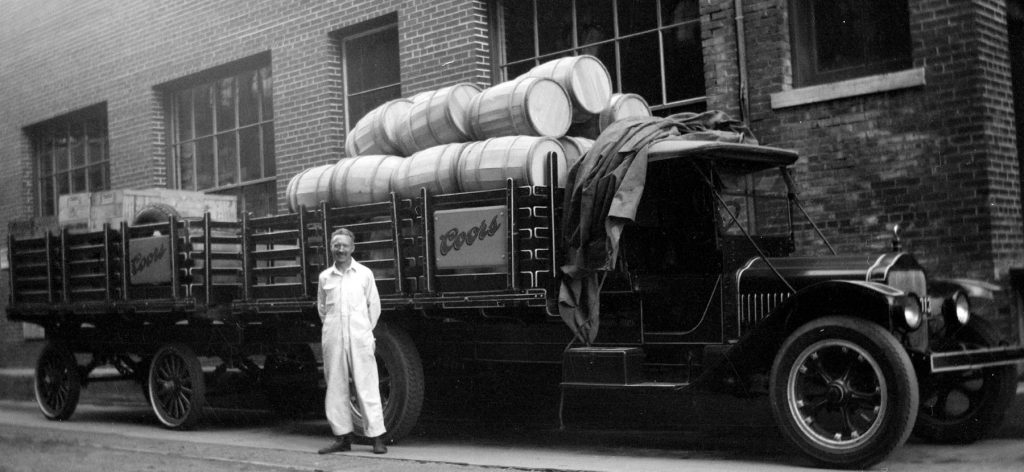 Old Coors truck with wood barrels in bed